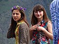 Young Women outside Gergeti Trinity Church - Outside Kazbegi - Georgia (18386550829) (2).jpg