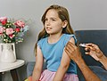 Young girl receiving a vaccine in her arm (48545835566).jpg