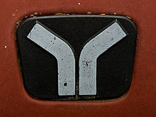 Yugo badge on a red Yugo GVL.jpg