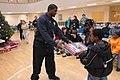 (Hurricane Katrina) Biloxi, Miss., December 13, 2005 -- FEMA representative Obadiah Cooper hands out presents to students of a local alternative school at the Disaster Recovery Cent - DPLA - 953e1529f8b15d252e9a9eb7acaeb0f0.jpg