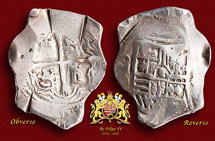 A silver 8-Reales (Peso) coin minted in Mexico (1621-65). 17th Century Spanish Treasure Silver 8 Reales Cob Coin.jpg