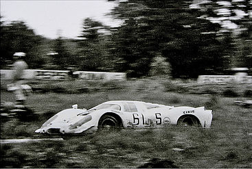 A black and white picture of a racing sports car.
