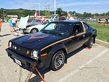 1978 AMC AMX at AMO 2015 meet in black with gold stripe 1of3.jpg