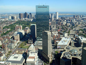 John Hancock Tower - The John Hancock Tower seen from the Prudential Tower; on the left is Copley Square (and Trinity Church), to the upper left is the Boston Common, on the right is the Massachusetts Turnpike (I-90) and to the top right is Logan International Airport.