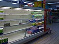 2008 Chinese milk scandal - empty milk shelves.jpg