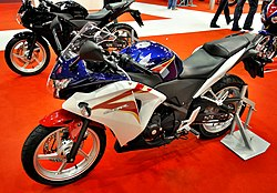 2011 Honda CBR250R blue red white at Motosalon.jpg