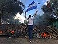 2018 Nicaraguan protests - woman and flag.jpg