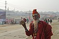 2019 Jan 18 - Prayagraj Kumbh Mela - Portrait of a Happy Damaru-playing Sadhu.jpg