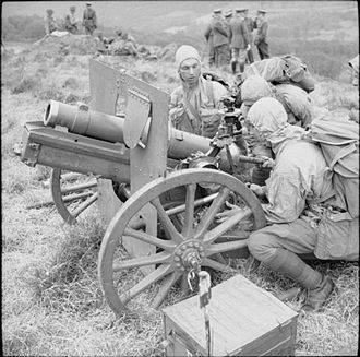 52nd (Lowland) Infantry Division - A 3.7 inch Mountain Howitzer of the 1st Mountain Artillery Regiment, Royal Artillery, attached to 52nd Division, on exercise at Trawsfynydd in Wales, sometime in 1942. The gun crew are wearing weatherproof anoraks, mountaineering breeches and woollen stockings.