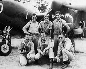 Thomas J. Lynch (aviator) - Aces of the 39th FS at Schwimmer Airfield, May 1943, in front of Lynch's P-38. Lynch is kneeling in the center of the front row.
