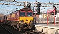 66125 heads south through Stafford with an Ellesmere Port-Southampton loaded car carrier.jpg
