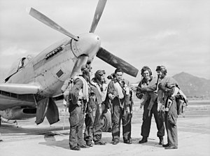 No. 76 Squadron RAAF - A group of pilots from No. 76 Squadron with a Mustang fighter in Japan, July 1947