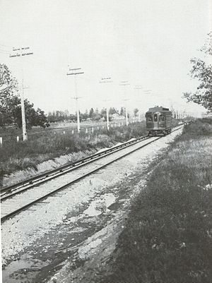 Chicago Aurora and Elgin Railroad - Car 12, pictured southwest of Wheaton on October 22, 1902. Note that the trains ran on a single track on this portion of the line.