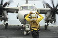 A U.S. Navy E-2C Hawkeye aircraft assigned to Carrier Airborne Early Warning Squadron (VAW) 117 is directed into position June 13, 2013, aboard the aircraft carrier USS Nimitz (CVN 68) while underway in the Gulf 130613-N-CV785-006.jpg
