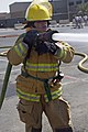 A U.S. Service member finishes the last obstacle of the Fire Prevention Week firefighter challenge at Camp Arifjan, Kuwait, Oct. 6, 2013 131006-A-OP586-192.jpg