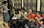 A beneficiary of USAID HIV Workplace Project talk to reporters on the sidelines of the event. (9092284136).jpg