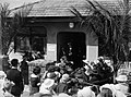 A crowd gathered outside a Plunket room (AM 80043-1).jpg
