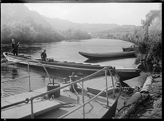 Taumarunui - A landing on the Whanganui River at Taumarunui in motorised boats
