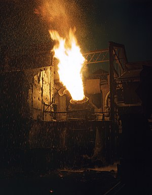 Republic Steel - Molten iron is blown in an Eastern Bessemer converter to change it to steel for war essentials, 1941