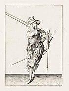 Aanwijzing 3 voor het hanteren van het musket - V furquet sincken laet, en van u schouder u Musquet neemt (Jacob de Gheyn, 1607)