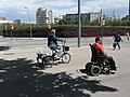 Adult tricycle and motorized wheelchair (18545092611).jpg