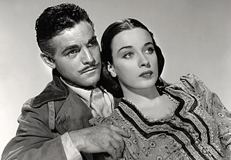 Alan Curtis (American actor) - Alan Curtis and Patricia Morison in Hitler's Madman (1943).