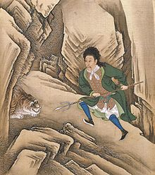 Painting of Chinese man, in Western clothes, attacking a tiger with a pitchfork-like staff