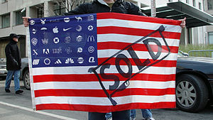 Corporatocracy - Protester holding Adbusters Corporate American Flag at Bush's 2nd inauguration, Washington DC.
