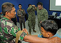 An Indonesian sailor applies a field tourniquet to another sailor during a subject matter expert medical symposium exchange as part of Cooperation Afloat Readiness and Training (CARAT) 2013 in Jakarta 130522-N-NX489-067.jpg