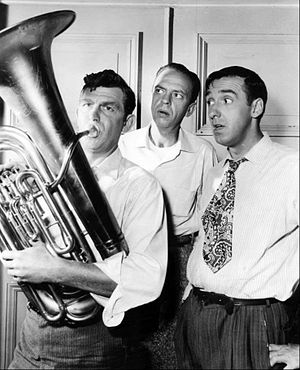 Andy Taylor (The Andy Griffith Show) - Andy helps the town band while Barney and Gomer look on.