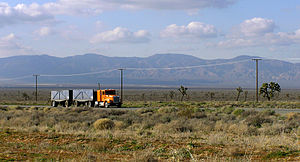 Antelope Valley - A truck passes eastbound along the busy Highway 58 through the Antelope Valley. The Tehachapi Mountains are visible in the distance.