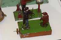 Antique wind-up toy fiddler and dancing bear (25257533494).jpg