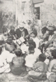 Arab people listening street music (from a book Published in 1931) P.155.png