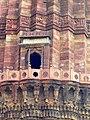 Arabic inscriptions above second floor balcony, Qutb Minar.jpg