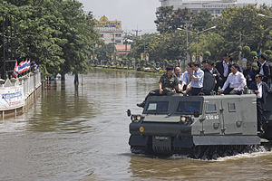 Bronco All Terrain Tracked Carrier - 2010 Thai floods, Thailand's prime minister Abhisit Vejjajiva surveying flooded regions from the relative safety atop a Royal Thai Army's Bronco troop carrier variant.