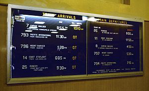 Amtrak Cascades - Departure board at Seattle's King Street Station in 1981, listing the Mount Rainier, the Pacific International, and other since-discontinued trains