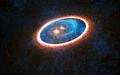 Artist's impression of the double-star system GG Tauri-A.jpg
