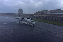 Asky-airlines-q400-douala-cameroon-in-rain.jpg