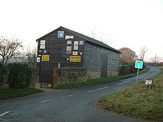 Barn with old signs, Buckland Common - geograph.org.uk - 90207.jpg