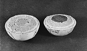 Baseball (ball) - Halves of two baseballs, illustrating the composition of the balls. On the left, a traditional cork-centered ball, and on the right, a rubber-centered ball.