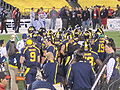 Bears in huddle at 2009 Poinsettia Bowl 2.JPG