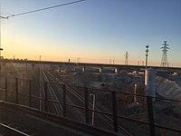 Beijing-Guangzhou HSR crossing above Fengtai-Shacheng Railway (20160325063409).jpg