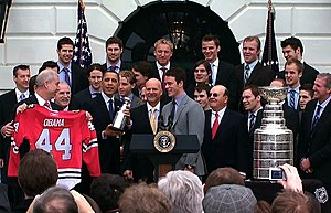 Jonathan Toews - Toews standing alongside the President of the United States Barack Obama during Blackhawks' ceremonial visit to the White House in 2010