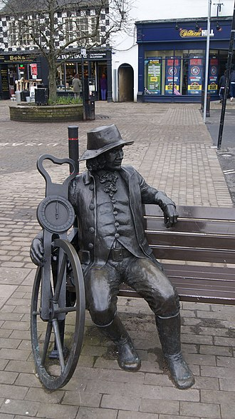 John Metcalf (civil engineer) - Statue of Blind Jack Metcalf, Market Place, Knaresborough, North Yorkshire. The device in his hand is a Surveyor's wheel.