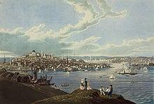 Obraz przedstawiający akwen z żaglowcami na pierwszym planie i miastem w tle