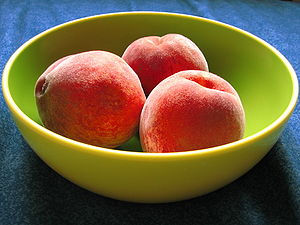 A bowl of peaches with colors enhanced. The Ca...