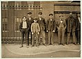 Boy on left hand end (hands in pockets) is Peter Carlos, 33 Waldron St. Been working in Mill No. 1 for 1 1-2 years. Smallest boy is Nicholas Karambles, 33 Waldron Street. Cocheco Mfg. Co., LOC nclc.01770.jpg