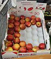 Braeburn apples for sale on a UK greengrocer's market stall in August 2013.jpg