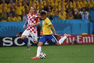 Ivan Rakitić - Rakitić playing against his then Barcelona teammate Neymar, at the opening match between Croatia and Brazil.