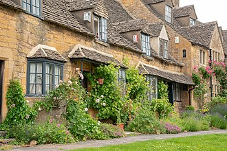 Broadway, Worcestershire - Tourists appreciate the quaint residential properties made of Cotswold stone (oolitic Jurassic limestone)